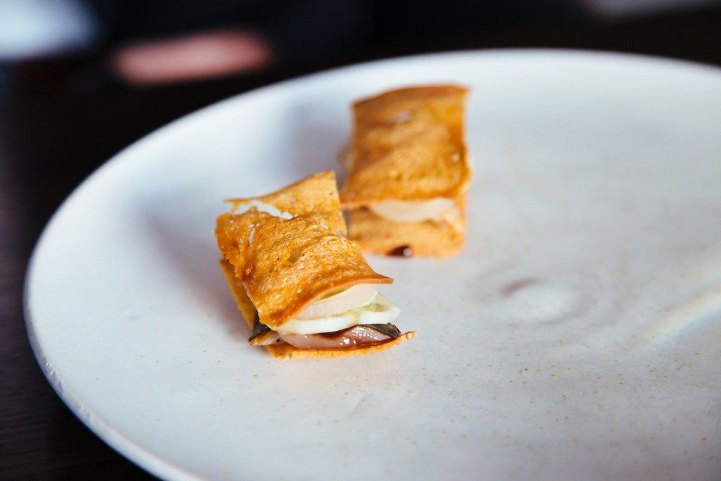 Glazed mackerel, black garlic and indian gherkin